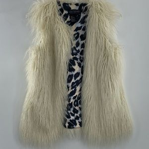 Ivory shaggy vest with animal print lining